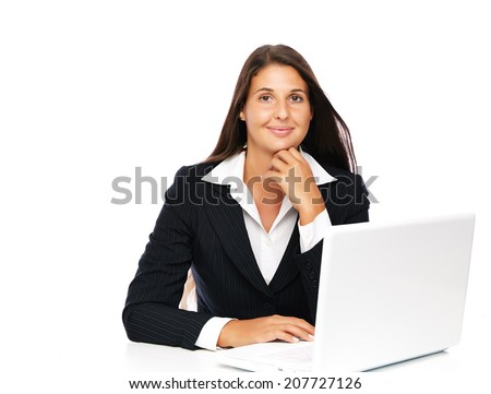 Business woman working on her laptop smiling looking to camera   Isolated on a white background.  - stock photo