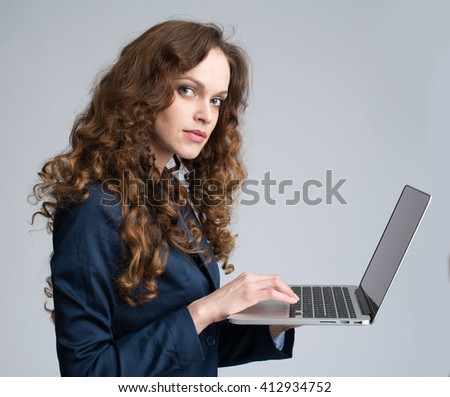 business woman working on laptop. Isolated on gray - stock photo