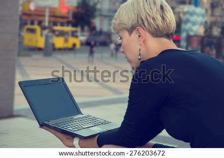 Business woman working with a laptop on the street city. Working in the office do not. Consultant in the working process. Private business.. Businessman working at laptop. City businesswoman working. - stock photo