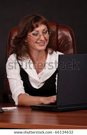 Business woman works in laptop - stock photo