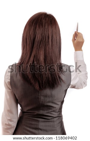 Business woman writes a pen with his back to the camera - stock photo
