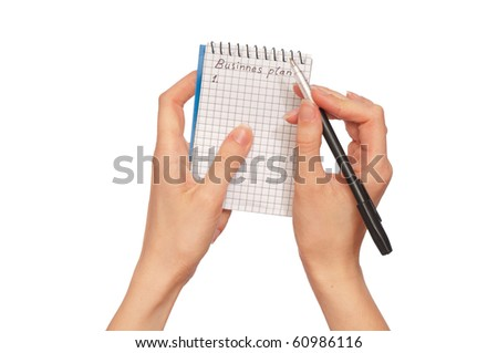 business woman writes mission for business plan - stock photo