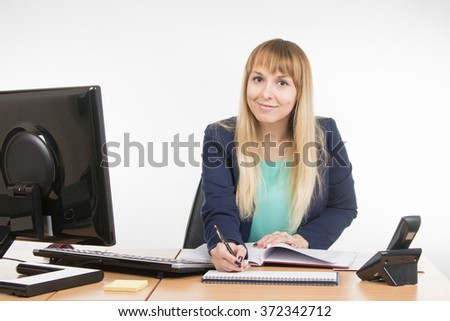 Business woman writing a note in the diary - stock photo