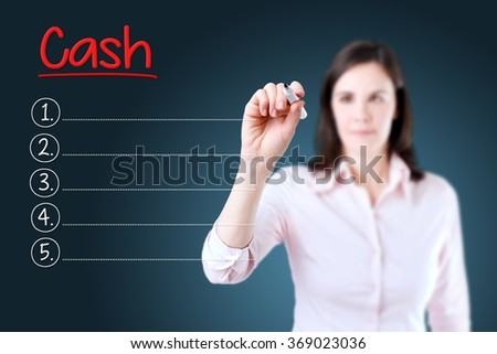 Business woman writing blank Cash list. Blue background.  - stock photo