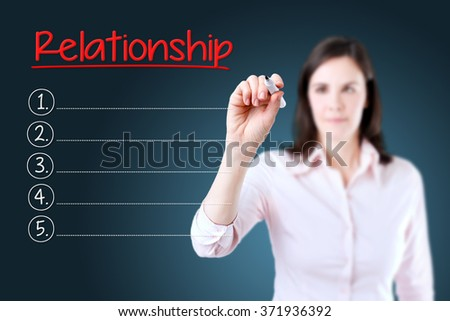 Business woman writing blank Relationship list. Blue background.  - stock photo