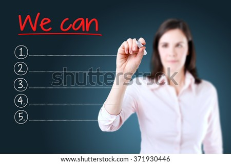 Business woman writing blank We Can list. Blue background.  - stock photo