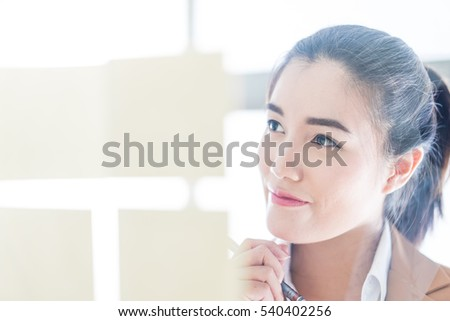 business woman writing on a glass