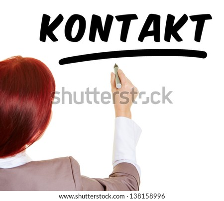 Business woman writing the German word Kontakt (meaning contact) with a pen - stock photo