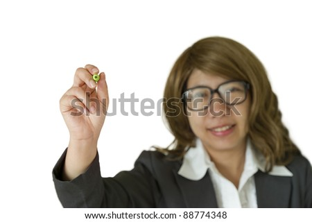 Business woman writing with green pen