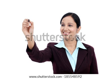 Business woman writing with pen on virtual screen with copy space against white