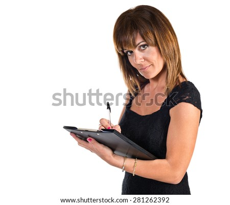 Business woman writting a document