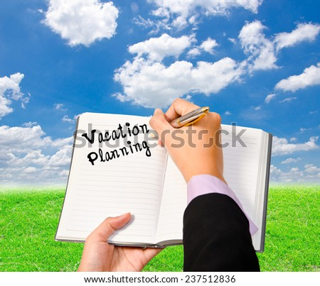 Business woman wrote on the notebook vacation planning on blue sky background. - stock photo