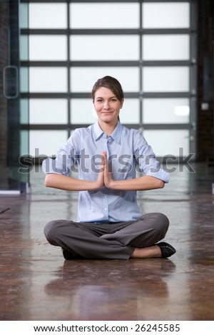 Business woman yoga at a modern office