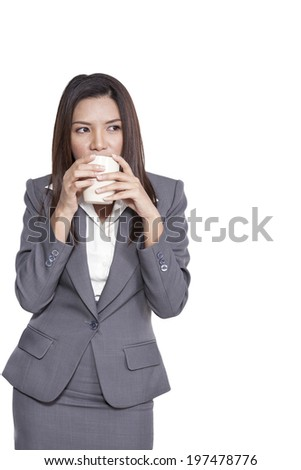 Business woman young pretty attractive beautiful asian model drinking coffee standing happiness relaxation thinking
