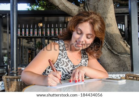 business women Check in Checkbook in the bar - stock photo