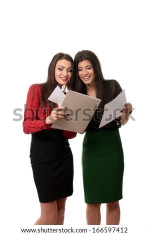 Business women doing paperwork - stock photo