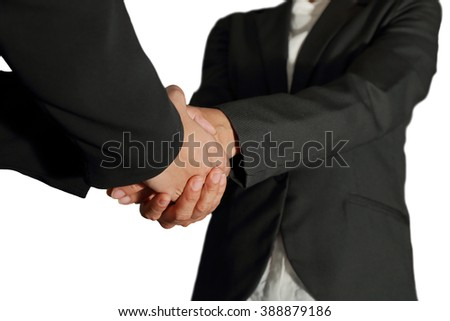 Business women double handshake as congratulation, welcome and hello concept.