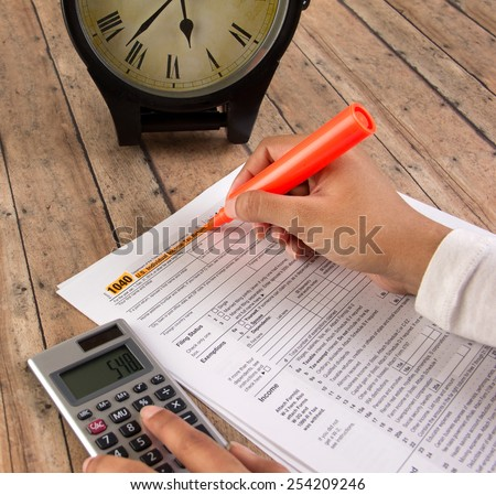 Business women filing federal tax before deadline - stock photo