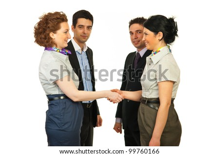 Business women giving hand shake in front of business men isolated on white background