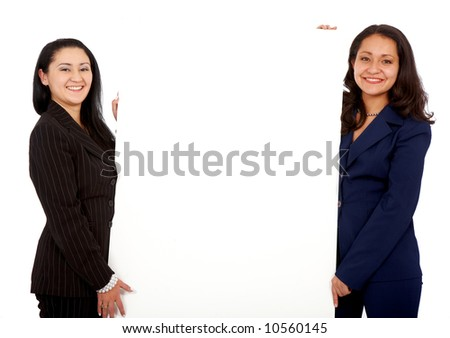 business women holding a banner add isolated over a white background - stock photo