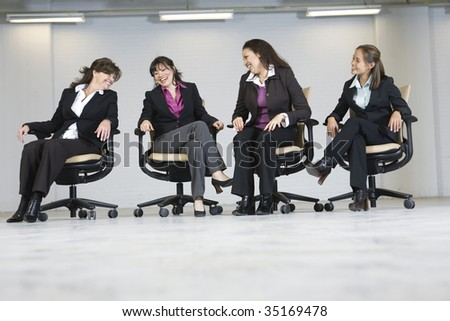 Business women laughing