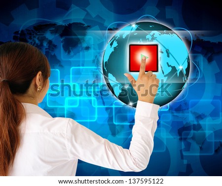 Business women pushing a button on a touch screen interface - stock photo