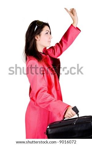 Business women signaling for a taxi - stock photo