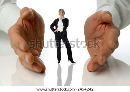 business women standing between male hands concept - stock photo