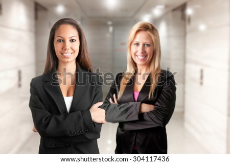 Business women with arms crossed  - stock photo