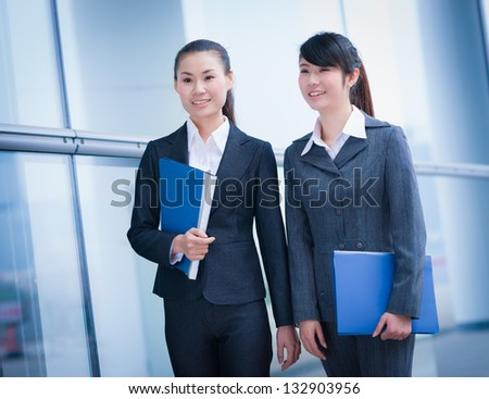 business women with folders in the office