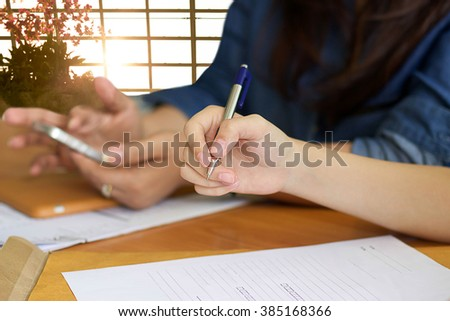 Business Women with hand holding a pen for filling agreement form