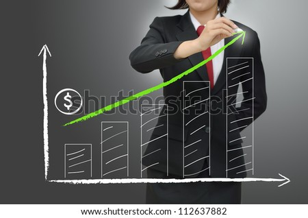 Business women writing green arrow - stock photo