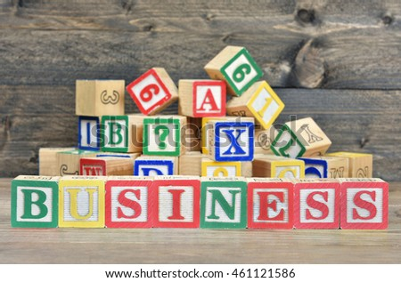 Business word on wooden table