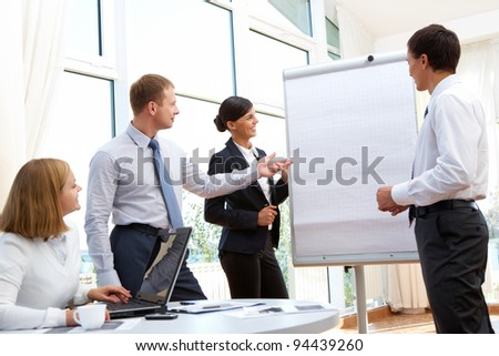 Business workgroup having a discussion about new business project - stock photo