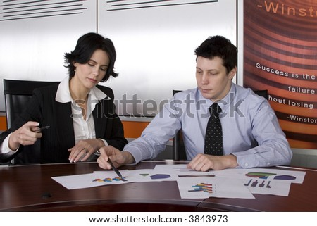 Business workgroup interacting in a boardroom setting - stock photo