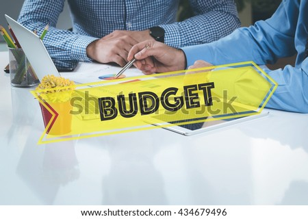 BUSINESS WORKING OFFICE Budget TEAMWORK BRAINSTORMING CONCEPT - stock photo