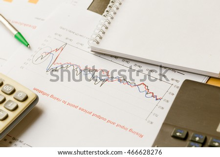Business working on project with laptop calculator and paper, Business growth