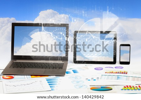 Business workplace with laptop, tablet and mobile phone - stock photo