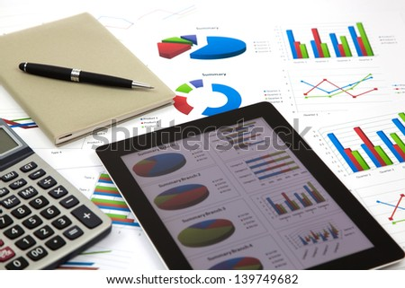 business workplace with stock market data - stock photo