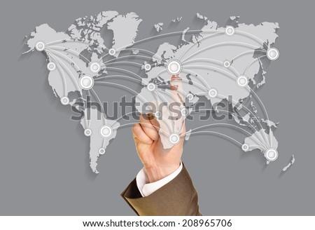 Business world, A businessman push on virtual world map - stock photo