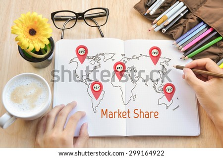 Business write market share on notebok. - stock photo
