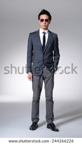 Business young man isolated full body   - stock photo