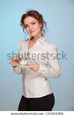 Business young woman drinking tea with a beautiful cup on blue background