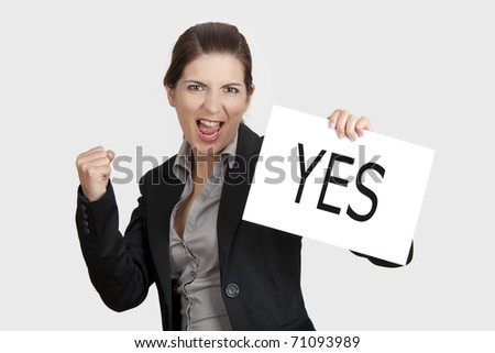 Business young woman showing a paper card with the word YES