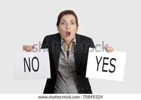 Business young woman trying to make a decision between Yes or No choice