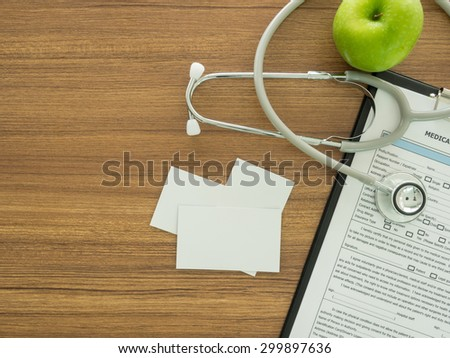 businesscard with  medicine equipment on desk'doctor. above view. - stock photo