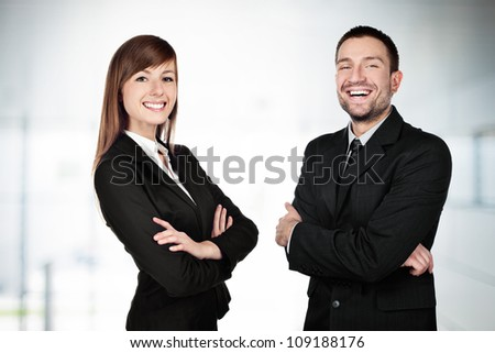 Businesscouple smiling - stock photo