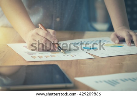 businessgirl working on Desk office business financial accounting calculate, Graph analysis, vintage color - stock photo