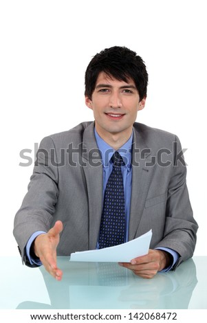 Businessman about to shake hand. - stock photo