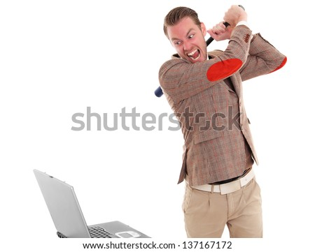 Businessman about to smash a laptop computer wearing a suit and tie. White background. - stock photo